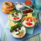 Bagel Smiles - Kids will have fun both eating and helping to make these cute, open-faced sandwiches.