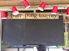 Redneck themed party with beer pong tourney board made with plywood and chalk board paint!