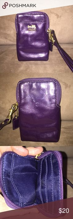Coach patent leather wristlet Eggplant purple, patent leather wristlet made to hold credit cards and a small amount of cash. It could potentially fit a smaller cell phone. Coach Bags Clutches & Wristlets