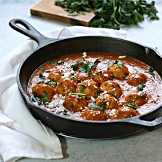 Recipe for chicken meatballs made with shawarma spice and cooked in a tomato sauce.