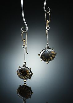 Fossil Ammonite Earrings.  Fabricated Sterling Silver, 14k and 18k. www.amybuettner.com https://www.facebook.com/pages/Metalsmiths-Amy-Buettner-Tucker-Glasow/101876779907812?ref=hl https://www.etsy.com/people/amybuettner