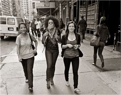 ladies walking down the street happily