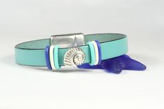 Leather bracelet with a screwed on shell decoration.  Magnetic clasp for easy to open and close with one hand.