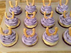 Vanilla cupcakes with royal icing horseshoes