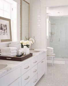 This timeless #bathroom by designer David Jimenez is simple, yet elegant. The beautiful counters and floors are in Calacatta Gold #marble.
