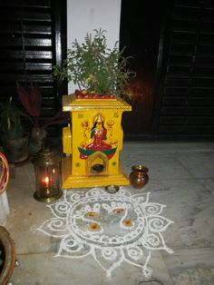 to a plant tulasi. Diwali Decorations At Home, Flower Decorations, Thulasi Plant, Front Wall Design, Diya Rangoli, Temple Design For Home, Pooja Room Door Design, Puja Room, Floating Flowers