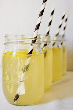 Black and white paper straws with lemonade to serve to the Mommy-to-BEE