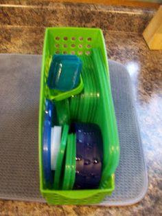 Magazine holder as Tupperware lid separator, no more mess..GENIUS.