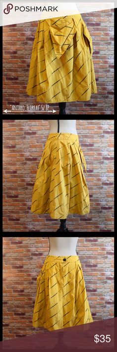 """Anthropologie Floreat Subway Stairs Skirt Anthropologie Floreat Subway Stairs skirt in a size 8 petite.  Big bow to the side of skirt.  Zipper and two button back closure with flat wait.  Has a tulle under layer and lining.  Measures 15"""" flat waist, 22"""" in length.  Shell is 100% cotton and lining is 100% cotton and trim is 100% nylon.  Stunning skirt in excellent condition. Anthropologie Skirts Midi"""