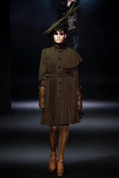 Another John Galliano Fall 2012 RTW. In this particular outfit , there is the combination of cape from 17-19th century, and a more modern military influenced trench coat.1/25/2015