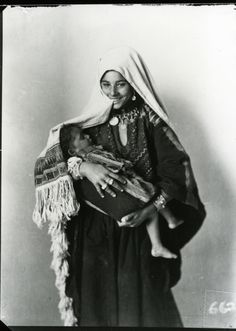 """A Palestinian Mother Smiling with her child in her arms in 1920 - Taken By Khalil Raad,  known as """"Palestine's first Arab photographer."""""""