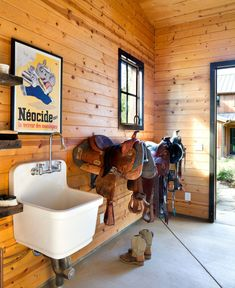 to Put a Farmhouse Sink in Your Barn - STABLE STYLE white farmhouse sink in the tack room 6 Reasons to Put a Farmhouse Sink in Your Barn - STABLE STYLE white farmhouse sink in the tack room 25 Amazing Chalkboard Wall Paint Ideas Horse Barn Decor, Horse Barn Designs, Horse Barn Plans, Barn Stalls, Horse Stalls, Dream Stables, Dream Barn, White Farmhouse Sink, Modern Farmhouse