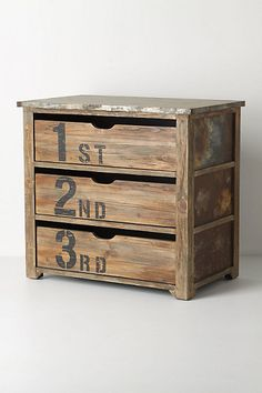 anthro : ordinal dresser : Artful distressing imbues this metal-topped wood piece with a well-loved look, while its three numbered drawers rank your socks, tees and sleep sets.