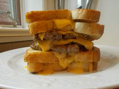 The Grilled Cheese Burger Burger Grilled Cheese Burger all stacked up and just waiting to be eaten. #foodporn #burger #hamburger #recipe #delicious