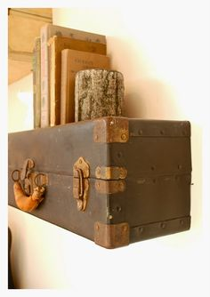 Repurposed suitcases make creative display shelves at Salvage Life in Long Beach via This American Home