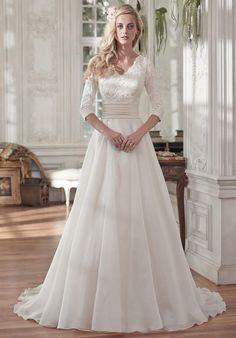 A-line dress with lace bodice, pleated Romance satin belt at the waist, and soft Vicenza organza skirt | Maggie Sottero | https://www.theknot.com/fashion/brentleigh-maggie-sottero-wedding-dress