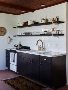 """thomasville """"bythe"""" cabinets from Home Depot in charcoal with snowy ibiza quartz counter from HD. Delta Trinsic single handle faucet from overstock kohler mayfield sink shelf brackets are Wallstirrups by etsy seller quaterertwenty."""