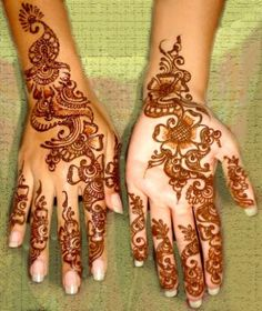 Mehndi--beautiful henna designs on back of hand and on palm, in flowing floral motif.