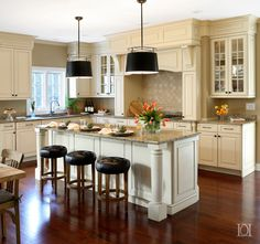 Kitchen refresh with Brazilian cherry floors and cream cabinets black shade pend Cherry Wood Kitchen Cabinets, Cherry Wood Kitchens, Wood Floor Kitchen, Cherry Kitchen, Kitchen Cupboards, Kitchen Flooring, Wooden Kitchen, Distressed Kitchen, Condo Kitchen