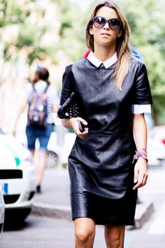 A black leather dress can easily be worn to work when layered with a simple collared shirt underneath. // #DaytoNight #StreetStyle