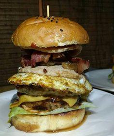 The BIG Jawbreaker Burger at @jimisburger Malad is so delicious!  We're trying to have all at once!  Photo credits - @abhishek_i  #burger #food #foodporn #cheese #delicious #foodie #foodgasm #jimisburger #thefoodstory #eatsleepdrinkrepeat