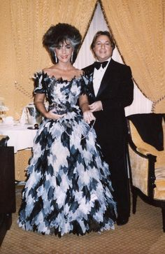Designer Arnold Scassi with actress Elizabeth Taylor. Arnold Scaasi (born May 8, 1930) is an acclaimed fashion designer who has created gowns for First Ladies Mamie Eisenhower, Barbara Bush, Hillary Clinton, and Laura Bush, in addition to such notable personalities as Joan Crawford, Ivana Trump, Princess Yasmin Aga Khan, Lauren Bacall, Diahann Carroll, Elizabeth Taylor, Catherine Deneuve, Brooke Astor, Arlene Francis, Mary Tyler Moore, and The Baroness Wendy DeVere-Austin. 1992