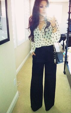 Black trouser pant, print sheer blouse, simple small bag