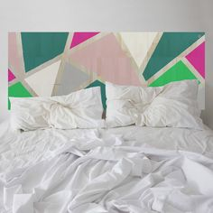 Romance is born. This KALEIDA headboard has been thoughtfully designed, balancing a kaleidoscope of fashionable colours. Strips of natural eco-wood are revealed between the coloured sections.
