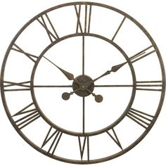 Perfect displayed in the entryway or hung over the fireplace, this oversized wall clock features an openwork design and an antique metal finish.