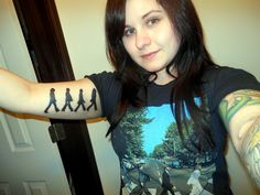 My newest tattoo! Beatles on abbey road & I'm in my abbey road shirt. :)