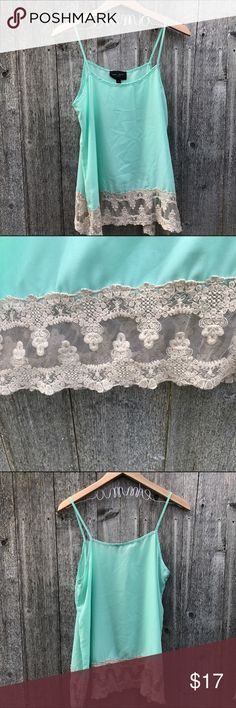 Beautiful Mint Blouse Fantastic mint blouse with lace detailing across the bottom. Works great as a tank top in the summer or with a  cardigan any time of the year! Tops Blouses