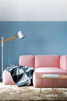 A pink sofa and Scandi-style lighting at East London hotel Leman Locke, designed with apartment living and co-working in mind