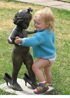 baby dancing with statue