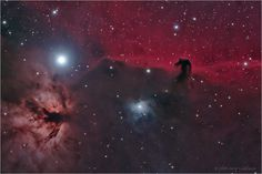 The Horsehead Nebula, B33, is the dark nebula in front of the bright red emission nebula IC 434. ~ Astrophotography by Jerry Lodriguss