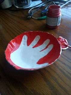 Sophie's hand print in a shallow bowl. Thanks, @For The Makers!!!