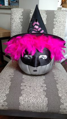 Breast Cancer witch... so easy and quick!!! All u need is to spare a pumpkin silver, glue on a pink boa for hair, a mask and a hat. Then a breast cancer ribbon on the hat. Draw in the eyes. Takes no time at all!