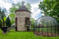 Our French neighbors have made this old stone tower into their chicken coop and check out the free range while cooped up dome.........