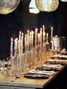 Elegant Halloween table lined with clear wine bottle candles. Love these candles for ANY party. Wine Bottle Candle Holder, Wine Bottle Centerpieces, Candle Centerpieces, Candle Holders, Centerpiece Ideas, Flowerless Centerpieces, Diy Centrepieces, Floral Centerpieces, Candle Arrangements