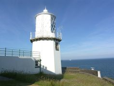 The Blackhead Lighthouse, Co. Antrim, Northern Ireland. It no longer functions as a lighthouse but is now a holiday home.