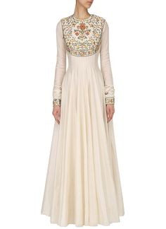 Buy White Embroidered Anarkali Gown online, SKU Code: BGWRDSVGWN79. This White color Party dresses and gown for Women comes with Embroidered Art Silk. Shop Now!