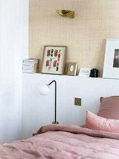 pink bedding and minimalist modern wall light fixture. / sfgirlbybay