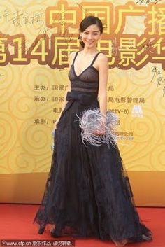 Angelababy looked youthful and chic in a lace bow adorned Valentino dress paired with a fun feathery gray clutch    Award Show Fashion: 14th Annual HuaBiao Film Awards | Fashionable Asians