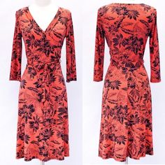 Floral Wrap Dress - Coral  S M L Floral knee length dress featuring a mock wrap, belt tie at waist and 3/4 sleeves. Sizes: S M L. Comment below with your size and I will create a separate listing for you to purchase. Dresses