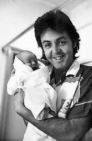 Paul and baby James. September 12, 1977. Photograph by Linda McCartney.