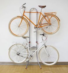 Michelangelo Two-Bike Gravity Stand 12 Space-Saving Bike Rack Solutions Indoor Bike Rack, Indoor Bike Storage, Bicycle Storage, Bicycle Rack, Bicycle Stand, Bike Storage For Small Spaces, Bike Storage Inside, Casa Gaudi, Bike Wall