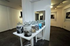 Decanting the Chaos-Photographs in glass jars