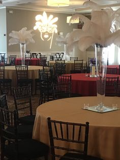 Tall feather centerpieces make the look for this masquerade theme prom!