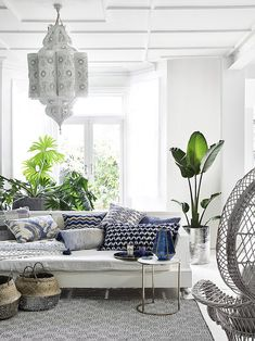 """Bohemian Decor :: The """"It"""" Decor For Eclectic Decorating Fusions - A bohemian styled white sitting room with a large Moroccan hanging latern, plants and seagrass bask - Morrocan Interior, Morrocan Decor, Moroccan Bedroom, Interior Design London, Luxury Interior Design, Interior Ideas, Grey Interior Doors, Fusion Design, Eclectic Decor"""