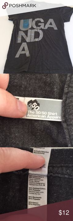 "American Apparel Uganda charcoal gray tee size M American Apparel 50/50 Uganda charcoal gray short sleeved tee size M. Length of shirt is approx 22.5"". In Good used condition. 50% combed cotton and 50% polyester. American Apparel Tops Tees - Short Sleeve"