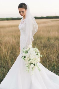 Ranch bride in hay field. Lace gown. Courtney Leigh photography #ranchwedding #lacewedding #countrywedding